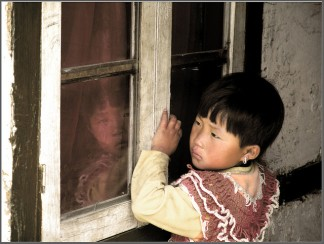 A little girl and her reflection, Darap village, near Pelling, Sikkim