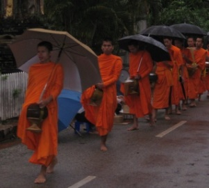 Mnks marching along early 5AM for alms