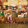 Unidentified Hindu pilgrims take bath and pray in the holy Ganges river